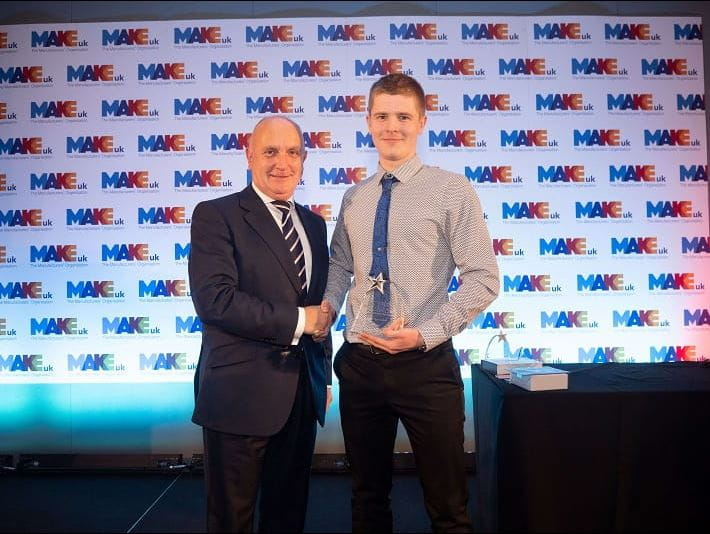 Winner of the Final Year Award, Harry Halford, receiving his award from Stephen Phipson